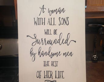 A Woman with all sons will be surrounded by handsome men the rest of her life wood sign