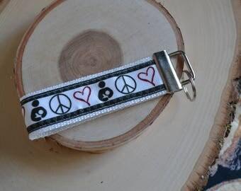 Peace, love, and breastfeeding keychain