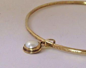 Gold bangle pearl bracelet