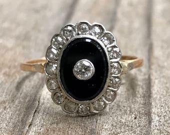 Onyx and diamond halo ring