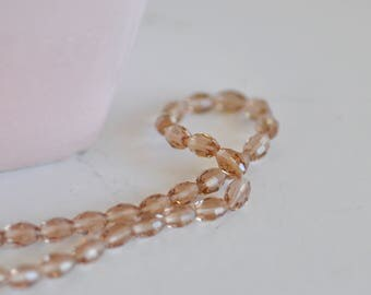 Oval shape - rice grain - set of 50 Beige faceted glass beads