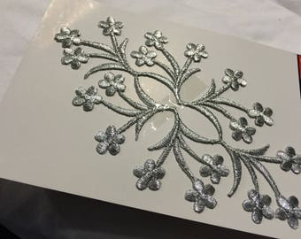 Embroidery has iron silver coloured 18 * 11 cm