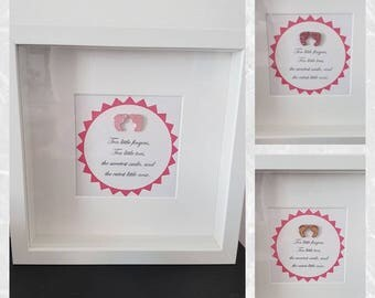 Cute baby girl feet frame with saying