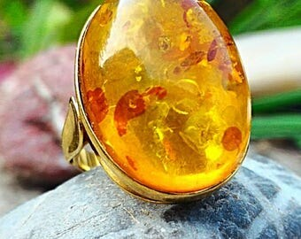Size 47, gold plated ring with Baltic amber, aligns the chakras