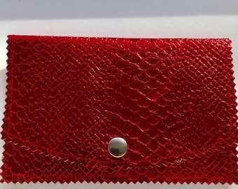 Red faux leather clutch