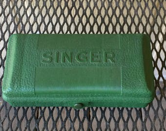 Singer button attachment