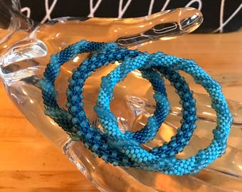 Roll On Glass seed beads Bracelet, Bangles, Made by Yours Truly,size small, set of 3, imported beads, beautiful blue sea glass like colors.