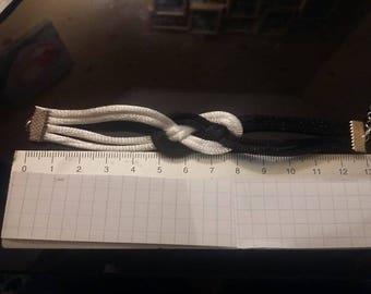 A black and white sailor knot bracelet.