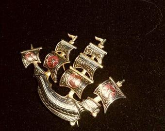 Damascene pirate ship brooch
