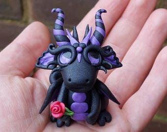 Polymer clay dragon, black and purple twist, red rose.