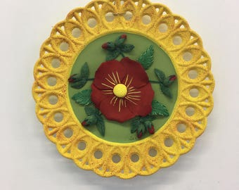 Decorative plate with red flower
