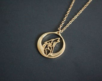 Gold tone howling wolf necklace