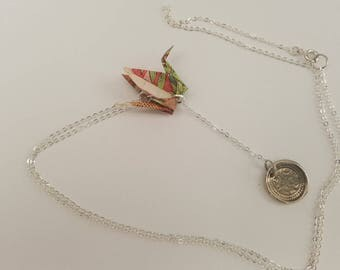Silver tone necklace with an origami crane-shaped