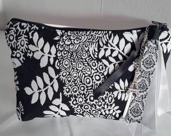 Small bi-material pattern zipper pouch