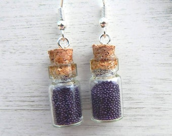Purple earrings with glass bottles