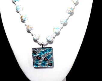 White and blue beaded necklace with glass enamelled pendant