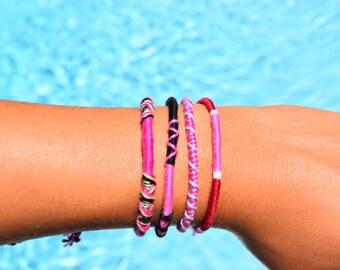 Assorted Pink String Bracelets