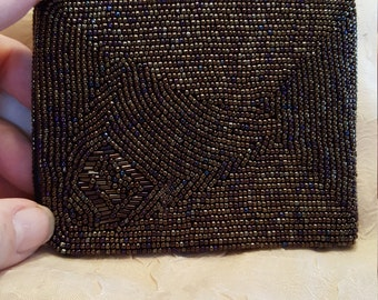Beautiful vintage multi colored sead bead wallet..woth 4 compartments. Like new!