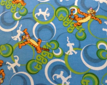 Flannel/Disney/Tigger on blue background cotton fabric by the yard