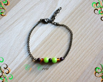 Bracelet mounted on a brass chain bronze with beads to fall