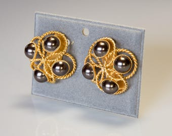 Vintage Earrings-60s-extravagant futuristic design, gilded brass braided with black beads. Abstract Modernist