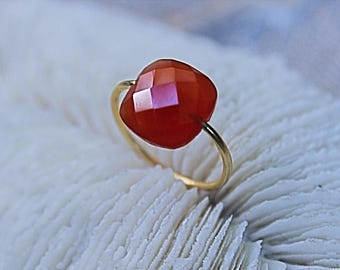 Yellow gold plated ring with a carnelian stone