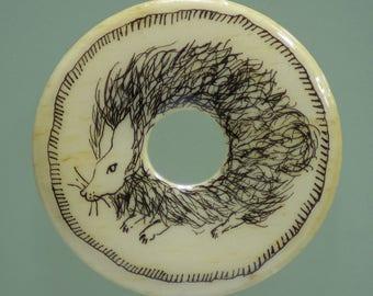 "Drawing on bone pendant, ""animal fur ball"""