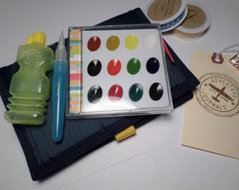 """POCKET WATERCOLOR TRAVEL Set (7""""x 6"""")-with brush, paper, water container, and paints all in a handy velcro pouch."""