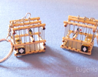 homemade cages of finches in miniature