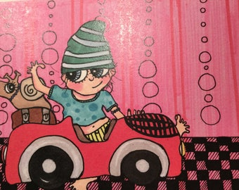 Boy in a red car