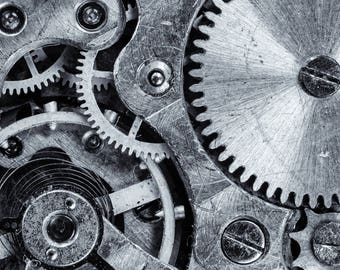 Macro photo of a watch mechanism, beautiful original decoration in black and white paper with lamination for protection