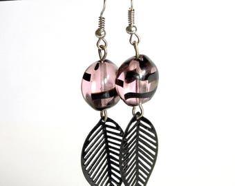 Earrings pink and black beads round flattened feline pattern