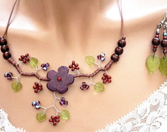 Purple/green/brown ceramic floral adornment
