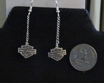 Biker metal charms  hung from silver colored chain