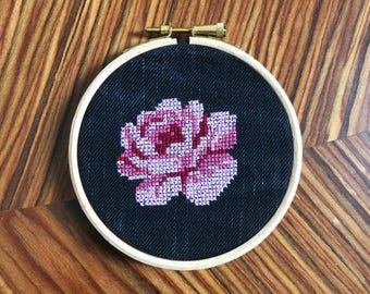 Pink rose cross stitch on up cycled denim