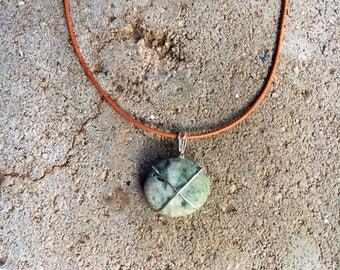 River rock pendant on leather necklace