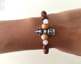 Beaded bracelet mottled red agate, white jade and wood with Buddhist Tibetan silver Bell