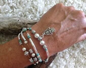 Double wrap silver noodle bracelet with hamsa charm