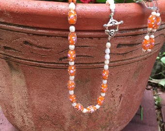 Orange glass beads with freshwater pearl necklace and earrings