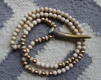 Long beaded wood necklace with antler tip pendant