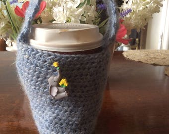 Pure wool coffee cup holder with a handle and elephant embellishment.