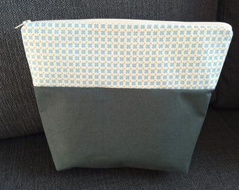 Toilet bag with peas and cross pattern
