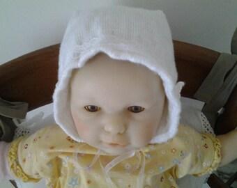 Knitted christening bonnet