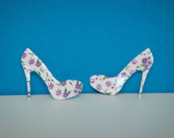 Hand cut pair of shoes in creating high quality gloss photo paper