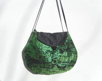 Green and black lamé fabric evening bag.