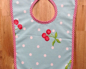 Cherry oilcloth bib and red gingham