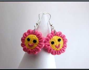 Earrings small kawaii Fimo fuchsia and yellow flower.