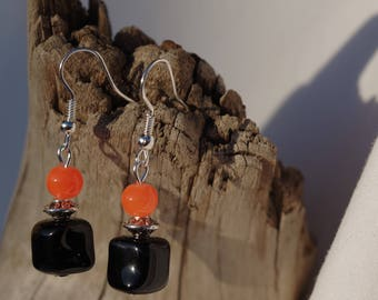 Orange earrings, 1 black square bead, 1 bead