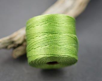5 yards - cord, twisted nylon fine • • 0.6 mm olive green thread