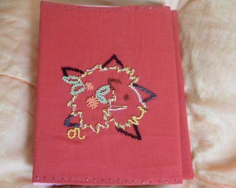 photo album covered in fabric with astrological sign of Leo